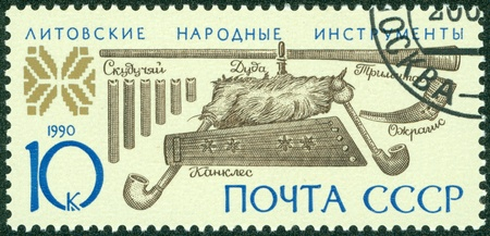 USSR - CIRCA 1990  A stamp printed in USSR shows Lithuanian folk musical instruments, circa 1990 Stock Photo - 14778451