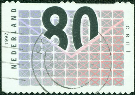 NETHERLANDS - CIRCA 1997  A stamp printed in Netherlands shows number 80 in envelope with Top Flap, circa 1997 photo