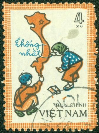 VIETNAM - CIRCA 1976  A stamp printed in Vietnam showing children drawing a map of Vietnam, circa 1976 photo