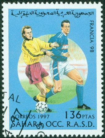 occ: SAHARA OCC RASD - CIRCA 1997  A stamp printed by SAHARA OCC RASD, shows 1998 World Cup Soccer Championships, France, circa 1997  Stock Photo
