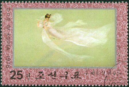 NORTH KOREA - CIRCA 1976  A stamp printed in North Korea shows flying fairy playing the flute, circa 1976 photo