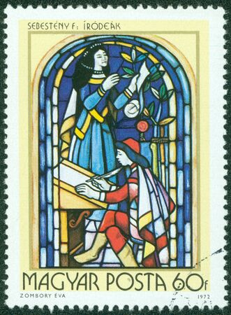 HUNGARY - CIRCA 1972  A stamp printed in Hungary, shows Stained-glass Window, 16th century scribe, by Ferenc Sebesteny, circa 1972 photo