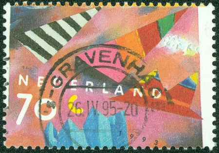 NETHERLANDS - CIRCA 1993  Greetings stamp printed in the Netherlands shows Collage, circa 1993 Stock Photo - 14830416