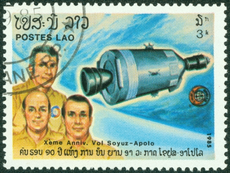 canceled: LAOS - CIRCA 1985  A canceled stamp printed in Laos shows image of the Sojoez - Apollo mission circa 1985