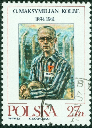 the stranger: POLAND - CIRCA 1982 a stamp printed in Poland showing an image of Maximillian Kolbe, the friar who volunteered to die in place of a stranger at Auschwitz circa 1982  Stock Photo