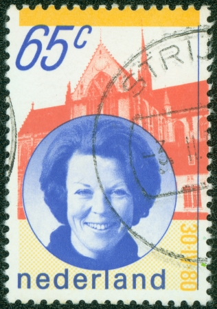 NETHERLANDS - CIRCA 1990  a stamp printed in the Netherlands shows Queen Beatrix and Palace, circa 1990