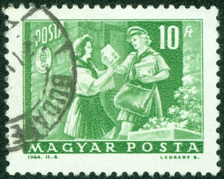 HUNGARY - CIRCA 1964  stamp printed by Hungary, shows girl pioneer and woman letter carrier, circa 1964