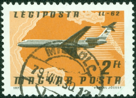 magyar posta: HUNGARY - CIRCA 1977   A stamp printed in Hungary, shows Airlines and Maps with the inscription  IL-62 , from the series  Airpost  , circa 1977