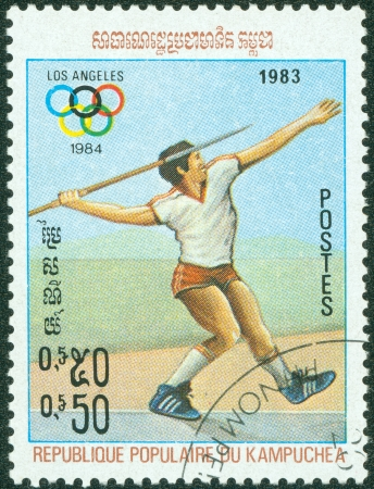 KAMPUCHEA-CIRCA 1983  A stamp printed in the Kampuchea, is dedicated to Summer Olympic Games in Los Angeles, Javelin throw, circa 1983 Stock Photo - 15108415