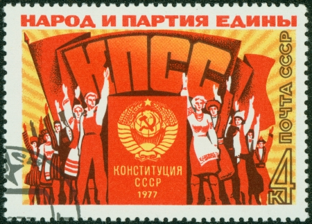 USSR - CIRCA 1977  A stamp printed in the USSR, shows a group of people at a rally meeting, the inscription  people and the party united,   Party,   constitution of the USSR in 1977  , circa 1977