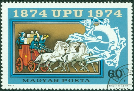 upu: HUNGARY - CIRCA 1974  A stamp printed in Hungary shows Old mail automobile, postbox, UPU Emblem, with the inscription  1874 UPU 1974 , from the series  Centenary of Universal Postal Union , circa 1974 Editorial