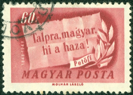 decrepitude: HUNGURY - CIRCA 1948  stamp printed by Hungary, shows slogan and olive branch, circa 1948 Stock Photo