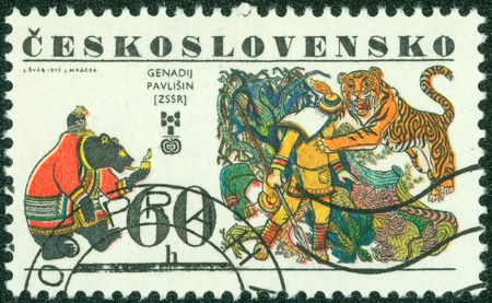 CZECHOSLOVAKIA - CIRCA 1977  A stamp printed in the Czechoslovakia, represented, 6th biennial exhibition of illustrations for childrens books,  Bear and tiger  by Genadij Pavlisin, circa 1977 Stock Photo - 15156999