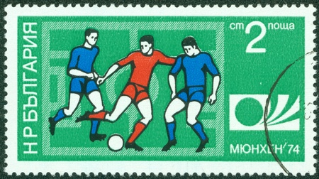 BULGARIA - CIRCA 1974  A Stamp printed in BULGARIA shows a football players and Munich  74 World Cup Emblem with the inscription  Munich  74 , from the series  FIFA World Cup 1974, Munich , circa 1974 Stock Photo - 15157000