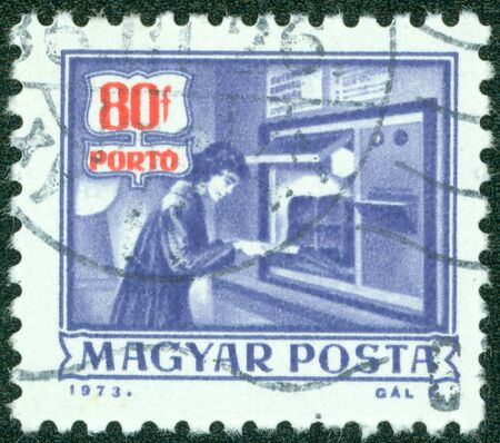 magyar posta: HUNGARY - CIRCA 1973  A stamp printed in Hungary shows automatic parcels registration machine without inscription, from the series  Postal Operations , circa 1973 Stock Photo