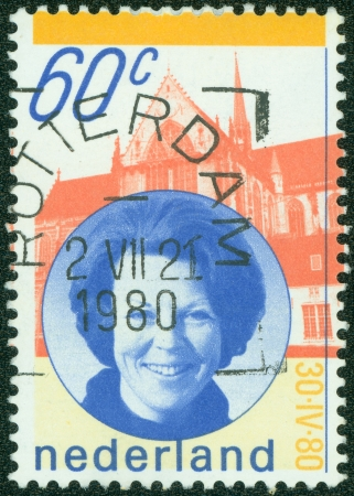 beatrix: NETHERLANDS - CIRCA 1990  a stamp printed in the Netherlands shows Queen Beatrix and Palace, circa 1990 Editorial