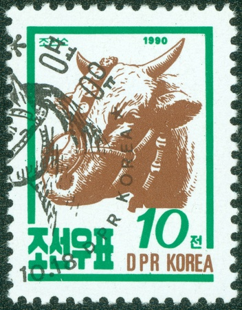 postmail: DPR KOREA - CIRCA 1990  A post stamp printed in DPR Korea  North Korea  shows farm animal cattle, circa 1990 Editorial