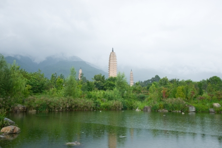 Three pagodas and water with reflection in Dali, China photo