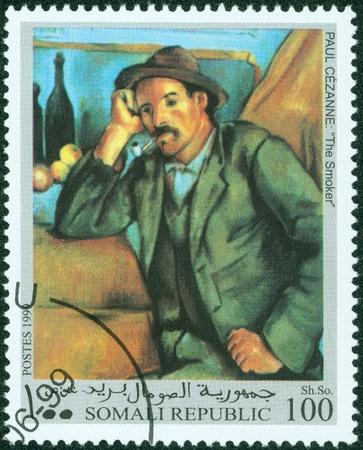 ソマリア-1999 年の頃郵便切手がソマリアで印刷されたは、1999 年頃ポール ・ セザンヌの喫煙者を絵を示しています 写真素材