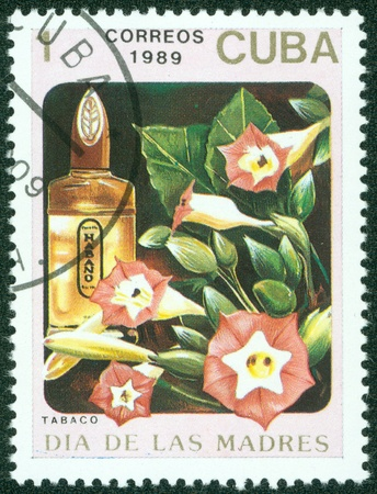CUBA - CIRCA 1989  A stamp printed in Cuba shows a bottle of Tabaco perfume, circa 1989 Stock Photo - 15621771