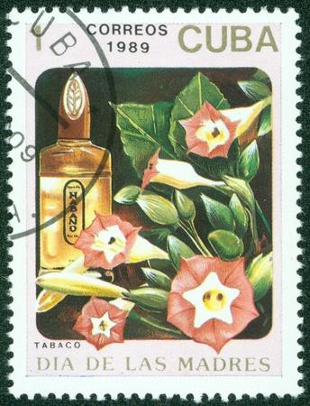 CUBA - CIRCA 1989  A stamp printed in Cuba shows a bottle of Tabaco perfume, circa 1989 Stock Photo - 15621771