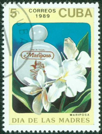 CUBA - CIRCA 1989  A stamp printed in Cuba shows a bottle of mariposa perfume, circa 1989 Stock Photo - 15621768