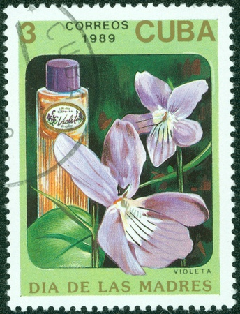 CUBA - CIRCA 1989  A stamp printed in Cuba shows a Bottle of Violeta perfume , circa 1989 Stock Photo - 15621772
