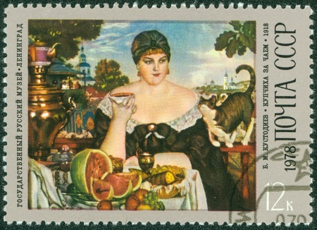 USSR - CIRCA 1978  A stamp printed in USSR shows the  Merchant s Wife Drinking Tea , from the series  B M  Kustodiev  1878-1927  Paintings , circa 1978 Stock Photo - 15854927