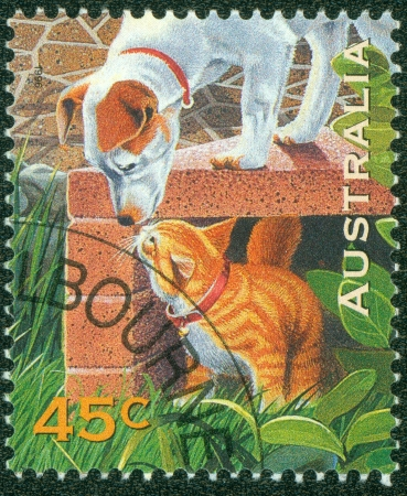 AUSTRALIA - CIRCA 1996  A stamp printed in Australia shows pet dog and cat, circa 1996