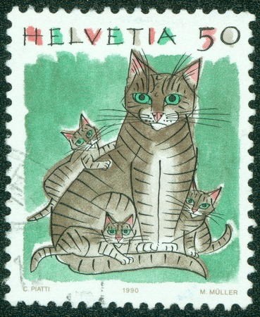 SWITZERLAND - CIRCA 1990  A stamp printed in the Switzerland shows a cat with kittens, circa 1990