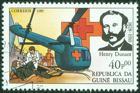 GUINEA BISSAU - CIRCA 1985  A stamp printed in Guinea Bissau shows Henry Dunant, founder of the Red Cross charity, circa 1985 Stock Photo - 15854917