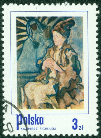 raggedy: POLAND - CIRCA 1974  A Stamp printed in POLAND shows the  Peasant Boy , by Kazimierz Sichulski, from the series  Polish paintings of Children , circa 1974