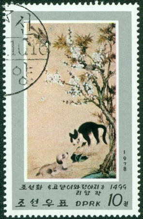 DPR KOREA - CIRCA 1978  A stamp printed in North Korea shows draw by artist Ame Lee  Kitten and Puppy , circa 1978
