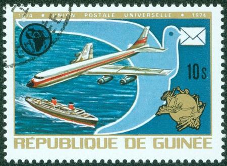 REPUBLIQUE DE GUINEE - CIRCA 1974   A stamp printed in Republique de Guinee shows a ship and plane, circa 1974 Stock Photo - 16043012