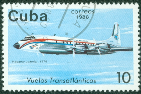 CUBA - CIRCA 1988  A Stamp printed in CUBA shows image of the airplane in transatlantic flight, Habana - Luanda in 1975, circa 1988