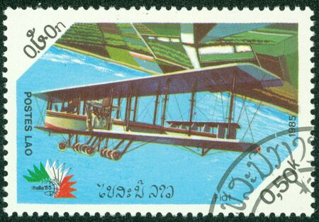 fiat: LAOS - CIRCA 1985  A stamp printed in Laos showing vintage biplane, circa 1985 Editorial