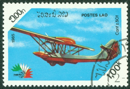 cant: LAOS - CIRCA 1985  A stamp printed in Laos showing Cant z 501 biplane, circa 1985 Editorial