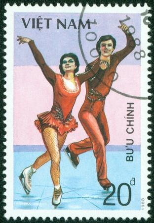 VIETNAM - CIRCA 1988  A stamp printed in VIETNAM shows figure skating, series sport, circa 1988 Stock Photo - 16233222