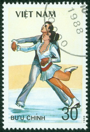 VIETNAM - CIRCA 1988  A stamp printed in VIETNAM shows figure skating, series sport, circa 1988 Stock Photo - 16233225