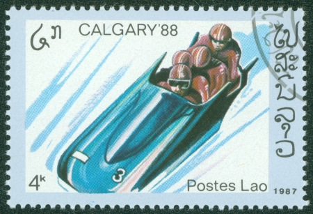 bobsled: LAOS - CIRCA 1987  stamp printed by Laos, shows bobsled, circa 1987