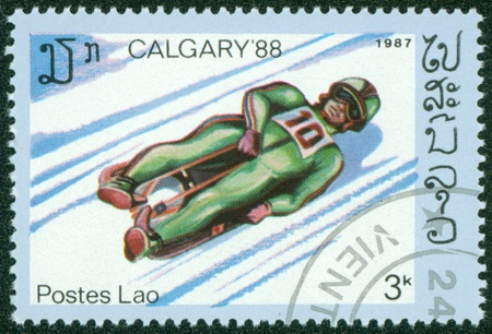 LAOS - CIRCA 1987  stamp printed in Laos, shows Toboggan with the inscription   Calgary 88 , from the series  Winter Olympic Games, Calgary 1988 , circa 1987 Stock Photo - 16233206