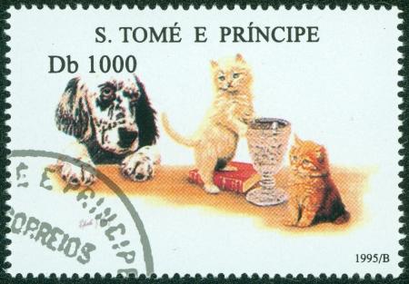 S  TOME E PRINCIPE - CIRCA 1995  A stamp printed in S  Tome e Principe showing dog with cats, circa 1995
