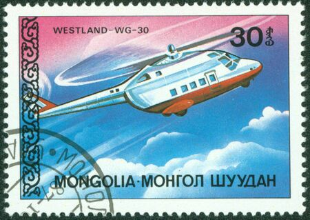MONGOLIA - CIRCA 1987  A stamp printed by Mongolia, shows helicopter, circa 1987 Stock Photo - 16320990