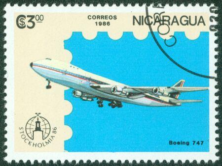 NICARAGUA - CIRCA 1986  A stamp printed in Nicaragua showing plane, circa 1986 Stock Photo - 16320945