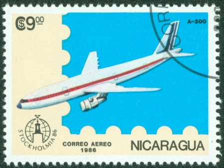 NICARAGUA - CIRCA 1986  A stamp printed in Nicaragua showing plane, circa 1986 Stock Photo - 16320944