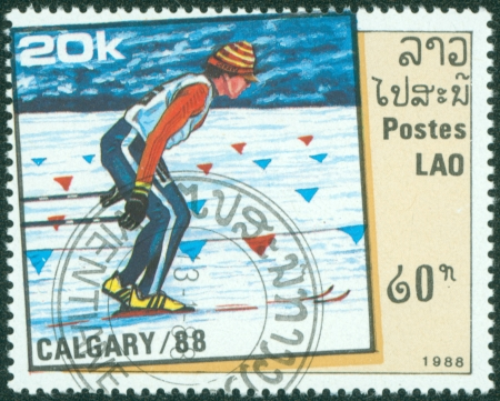 LAOS - CIRCA 1988  stamp printed by Laos, shows country skiing, circa 1988  Stock Photo - 16372593