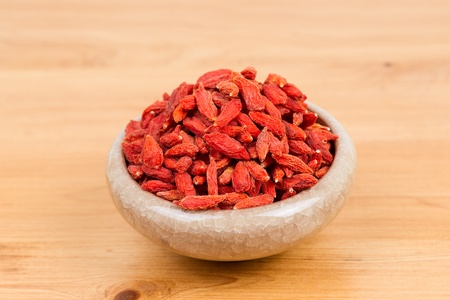 dried wolfberry fruit in bowl on the table photo