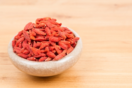 superfruit: dried wolfberry fruit in bowl on the table