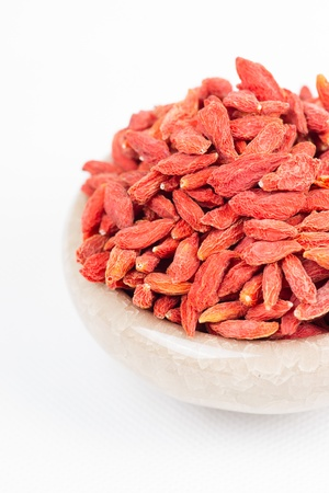 superfruit: dried wolfberry fruit in bowl on white background