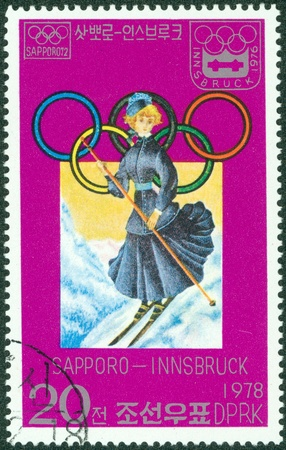 KOREA DPR - CIRCA 1978  stamp printed by Korea DPR, shows Winter Games, Sapporo-Innsbruck, 18th century woman skiier, circa 1978 Stock Photo - 16507234